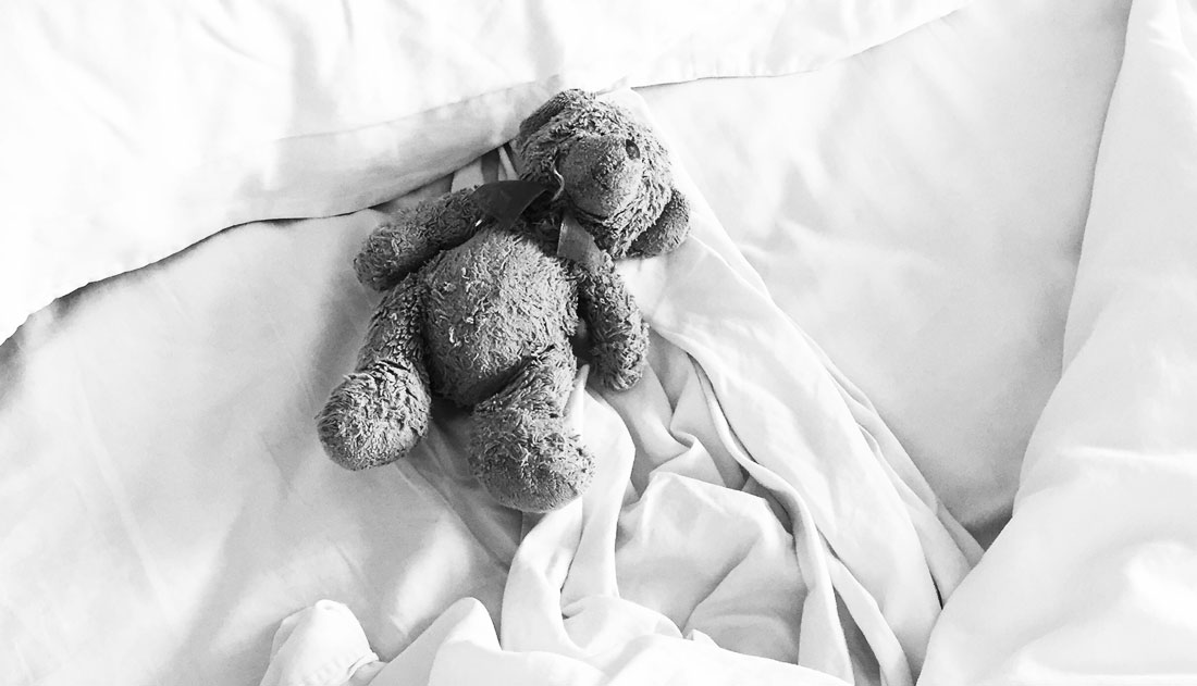 black and white image of a teddy bear