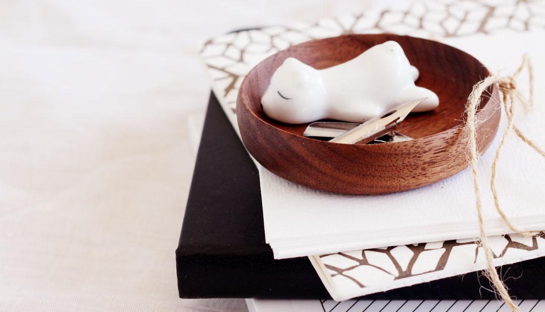 nibs and polar bear in brown dish
