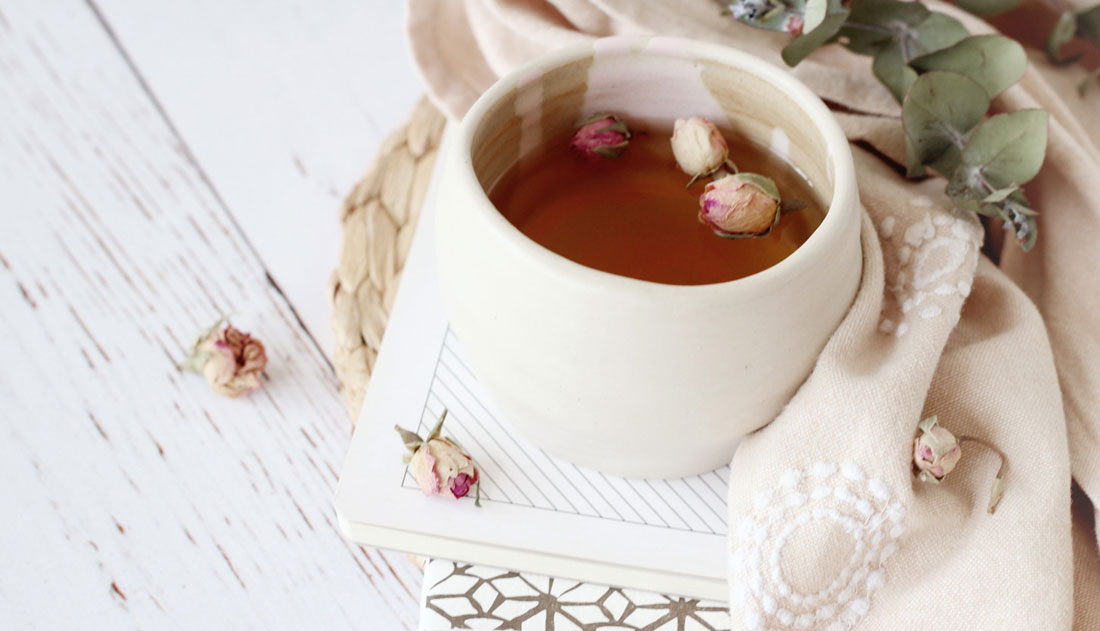 ceramic cup of tea with rose buds