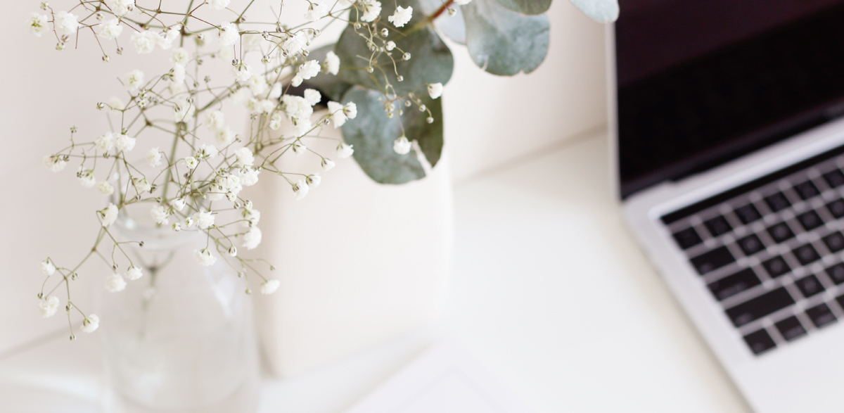 workspace with white vase and babies breath and gum